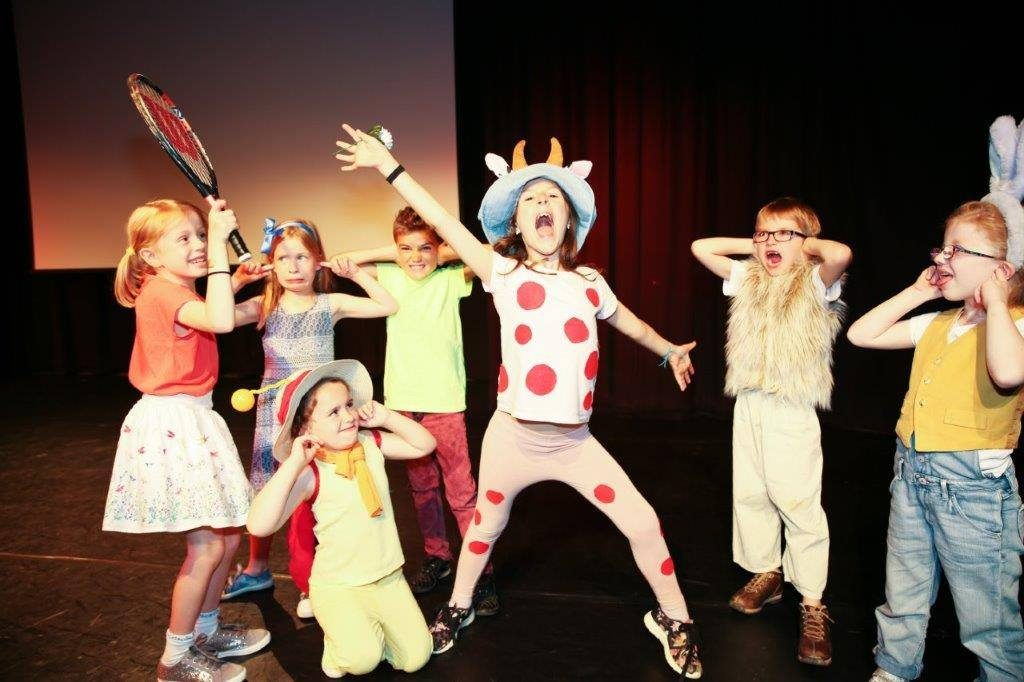 Children's theatre group on stage
